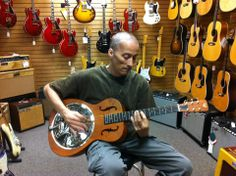 Garry's last Father Day. He went with his daughter, Emily to try out new guitars. After years of long hair, he had just shaved it off to stop the chemo from taking it from him in clumps