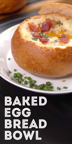 Baked Eggs In Bread Bowl Recipe | This recipe shows that bread bowls can house more than soups and dips! Treat your guests to their personal egg bowl at your next brunch. The eggs are baked directly inside a crisp roll and topped —  of course — with cheese and bacon! Click for the video and recipe. #breakfast #eggdishes