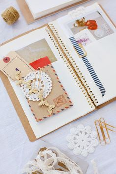 I love this idea -- using a journal with pocket pages to enclose papers, attach mementos, and jot down notes.