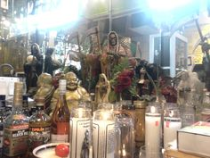 A public Santa muerte altar at a Mexican grocery store in Chicago. Alongside hotei a bodhisattva of wealth (specifically for business).