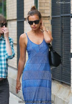 Irina Shayk out and about in New York City wearing a blue patterned maxi-dress http://icelebz.com/events/irina_shayk_out_and_about_in_new_york_city_wearing_a_blue_patterned_maxi-dress/photo1.html