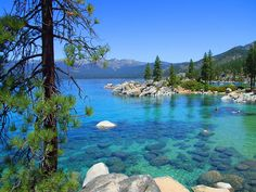 """At Sand Harbor"" by RevMac The air was hot, dry, with no wind. It was the perfect day for people to enjoy the water."