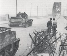 "Two soldiers of the US Airborne Division watch as Cromwell tanks of the Guards Armoured Division of the Armoured Recon Battalion the Welsh Guards cross Nijmegen bridge in Netherlands, Thursday, September ""Market Garden"" Airborne Army, 82nd Airborne Division, Operation Market Garden, Cromwell Tank, Holland, Military Operations, History Online, Journey, World Of Tanks"
