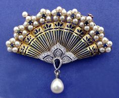 BROOCH:yellow and white gold,18 diamonds1,15 ct.,10 sapphires 1,04 ct., 48 pearlsandenamels ...