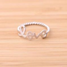 silver love ring with twisted ringline by bythecoco on Zibbet