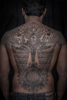 Thomas Hooper is a tattoo artist, illustrator and designer who lives in New York city. Although he is not currently taking new clients for tattoos, Hooper's renown as an exceptional tattoo artist remains. His signature mandala pattern style is unique and although others have tried to mimic his work, Hooper's tattoo designs have a quality of composition that is unreachable by most.