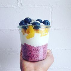 Raspberry coconut chia, coconut kefir, mango, blueberries, hemp seeds, and coconut.
