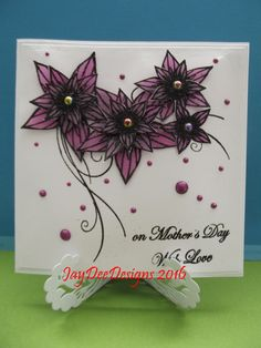 Honey Doo Flowers for Design Stamped on to opaque vellum.heat embossed,then coloured on the reverse with Promarker.