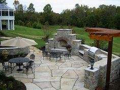 Love this patio, fireplace, and retaining wall!