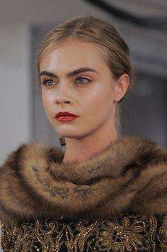 Think fur accents, scarves and stoles a la Cara at the Oscar de la Renta Fall 2013 show