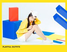 Styling yellow jumper with white shorts.  asian idol fashion set. --------------------------------------------  personally love their graphic