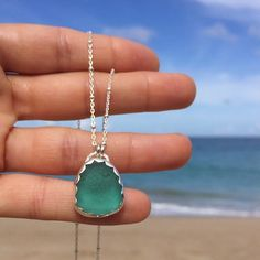 This gorgeous teal sea glass in a scalloped setting comes on an adjustable beaded sterling silver chain. Available by DM.  #teal #seaglass #jewelry #handmadewithlove #hechoenpuertorico