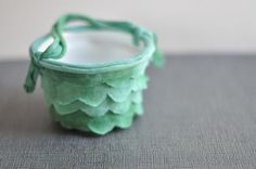 DIY Simple Green Scallop May Basket by designmom:  Made from a plastic cup and a small bit of fabric.  #DIY #Kids #May_Basket