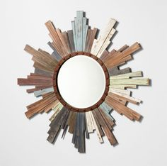 Multi colored distressed wood creates a chic version of the typical starburst mirror Dimensions: 39.5(dia) 1.5(ext)