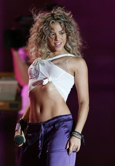 Shakira has had rocking abs for as long as we can remember—look back at all of her hottest moments.