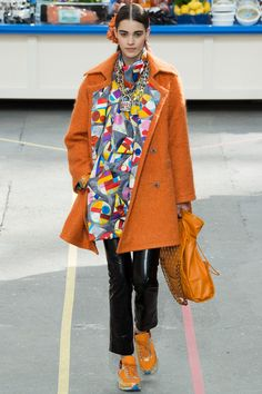 More Chanel.  The orange sneakers and the lining on the jacket may not cause someone to lower the gaze but the look is lovable.  - Urban Hijab