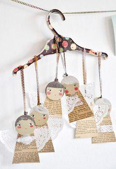 DIY; Angels from book/ newspaper pages (body), paper doillies (wings) and painted cardstock (faces). DIY; Engeltjes van Boek/ Kranten Pagina's en hun vleugeltjes geknipt uit papieren taart onderleggers, gezichtjes uit karton en geheelophangen met mooi lintje.