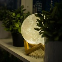 Description: Enjoy gazing at a full moon every night of the year by giving your bedroom some ambient lighting with this moon night light. The lamp emits two t