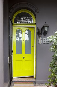 A brave colour combo – charcoal exterior and fab neon chartreuse front door! Photo – Jason Busch, production – Lucy Feagins / The Design Files.a neon yellow door Yellow Front Doors, Front Door Colors, Bright Front Doors, The Doors, Windows And Doors, Exterior Design, Interior And Exterior, Gray Exterior, Interior Office