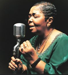 "Cesária Évora was a Cape Verdean popular singer. Nicknamed the ""Barefoot Diva"" for performing without shoes, she was also the ""Queen of Morna"". - Wikipedia"