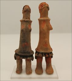 Gudza dolls, Turkana, Kenya.  Two small standing fertility dolls in clay, named Gudza, from the Turkana people. Dressed with an apron, heads...