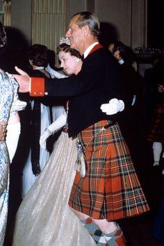 Queen Elizabeth II and Prince Philip, dancing in Scotland in 1982