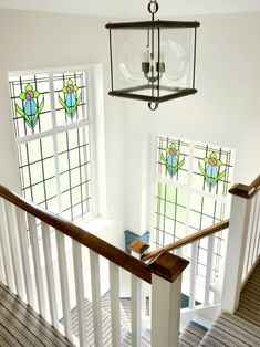 via House of Turquoise: Love everything about this stairwell.  The pendant light, the stained glass windows .... light and airy