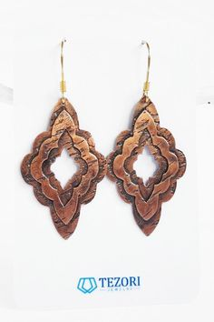 Boho Chic Summer Festival Earrings Bohemian blue and gold leather leaf lightweight statement earrings with stainless steel studs
