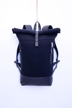 Amazing! MKI Black rolltop bag in heavy wool and leather