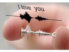 Earrings 3D printed using sound wave data from the phrase 'I love you'. from www.Shapeways.com