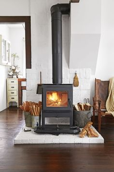 chimney:Wood Stove Decor Awesome Wood Burner Chimney Wood Burning Stove With White Brick Thrilling Wood Stove Chimney Draft Problems Fearsome Wood Burner Chimney Liner Memorable Wood Stove Chimney Pipe Lovabl Wood Burner Chimney Wood Stove Hearth, Brick Hearth, Wood Burner, Wood Stove Decor, Wood Stove Wall, Wood Stove Surround, Farmhouse Fireplace Mantels, Stove Fireplace, Cozy Fireplace