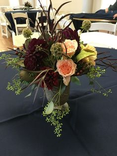 Navy blue gold and burgundy wedding flowers and bridesmaids dresses #marsalaweddings #