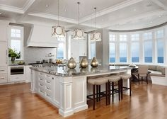 White Kitchen Design ideas. Custom-designed white kitchen with Sub-Zero, Wolf and Miele appliances . White Kitchen Paint Color: Benjamin ...
