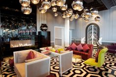Lighting - Light fixtures hung in multiples and at different heights make an impact in this hotel lobby.