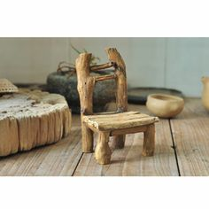 """Log Chair is a perfect piece for any fairy garden whether in a large outdoor garden setting or in a flower pot. This carefully crafted piece is cast in quality designer resin and hand painted to capture every little detail. Dimensions: 5 1/4""""H x 3 1/2""""W x 3 1/2""""D Material: Hand painted resin $12.75"""