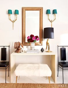 A layered collection of high and low price point pieces // sconces, shearling, entry console