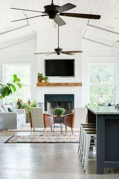 a peek from the kitchen to the living space in this Vintage Eclectic Barn | coco kelley