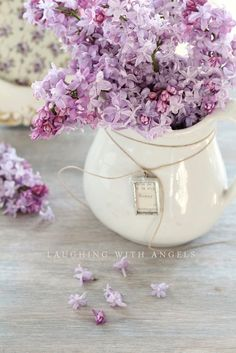 ♕ love June's addition of a tag to the pitcher of lilacs
