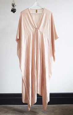 supersoft handwoven silk caftan with plunging v Color: pale flesh pink - — Length - — one size - — Free domestic shipping for purchases Kaftan Style, Caftan Dress, Boho Fashion, Fashion Outfits, Womens Fashion, Minimalist Wardrobe Essentials, Kaftan Designs, Kimono Fabric, Textiles