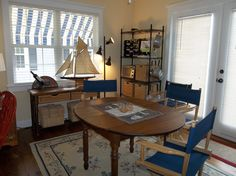 My little dining room area.  The baskets worked out great for storing kitchen stuff.  Love my canvas awnings!