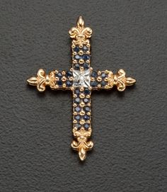 Estate Jewelry:Pendants and Lockets, Blue Sapphire & Diamond Gold Cross. ... (Total: 1 Items) Image #1http://jewelry.ha.com/c/item.zx?saleNo=171241=74069