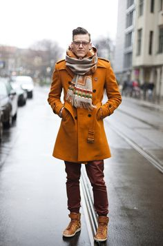 Orange, slim fit and belted... this coat is not one for the faint at heart. What a bold piece.