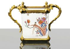 A small porcelain gilt-bronze mounted flower pot, the porcelain Kakiemon, Japan, 18th century, the mounts late Louis XV, circa 1770.
