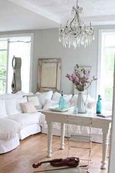 this explains why I dream of decorating in all-white    eclectic living room by Dreamy Whites
