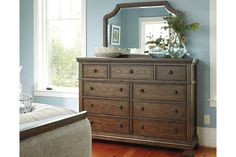 Merging a simple, straightforward profile with painstaking details, including classic egg-and-dart moulding, the Larrenton dresser and mirror set gives traditional design elements a wonderful sense of relevance. Vintage-inspired finish is loaded with character. Nine drawers that include a felt-lined jewelry tray beautifully accommodate your wardrobe.