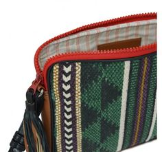 Hand woven and hand printed pouch cross body bag with leather tassel.