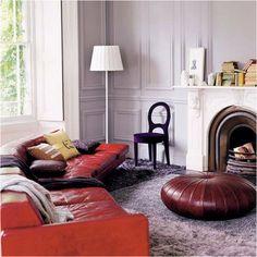 Lavender wall, coral sofa