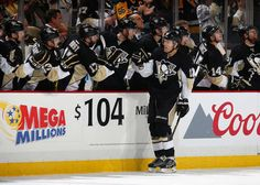 Ben Lovejoy #12 of the Pittsburgh Penguins celebrates his goal with the bench during the first period against the Detroit Red Wings at Consol Energy Center on February 18, 2016 in Pittsburgh, Pennsylvania. (Photo by Gregory Shamus/NHLI via Getty Images)