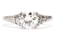 Gibson is a gorgeous Art Deco engagement ring made from 18k white gold featuring a luscious 1.55ct EGL certifed Old European cut diamond. Enhanced by its exquisite hand engraving and subtle stepped down shoulders this ring is a great example of classic Art Deco. Size 10.5.  Trumpetandhorn.com |