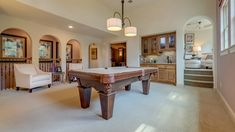 Play a game of pool with friends in the game room with wet bar at Creekside Park, Timarron Lakes Luxury Patio by Darling Homes. #billiards #table #gameroom #new #home #houston #pooltable